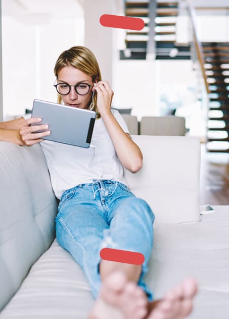 Woman on couch with Ipad