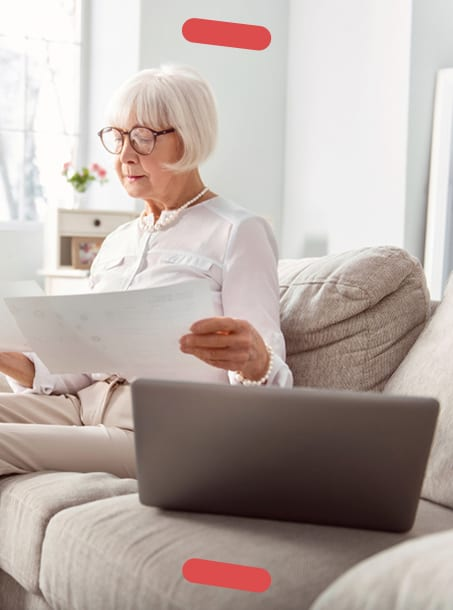 Older woman sitting with laptop