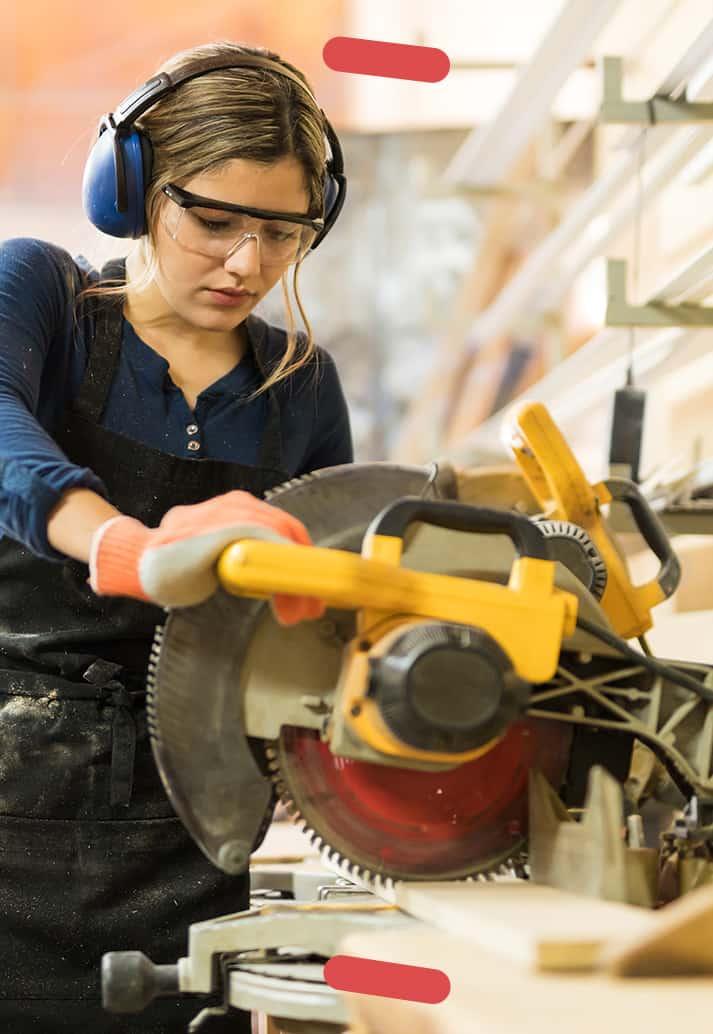 Woman using power saw